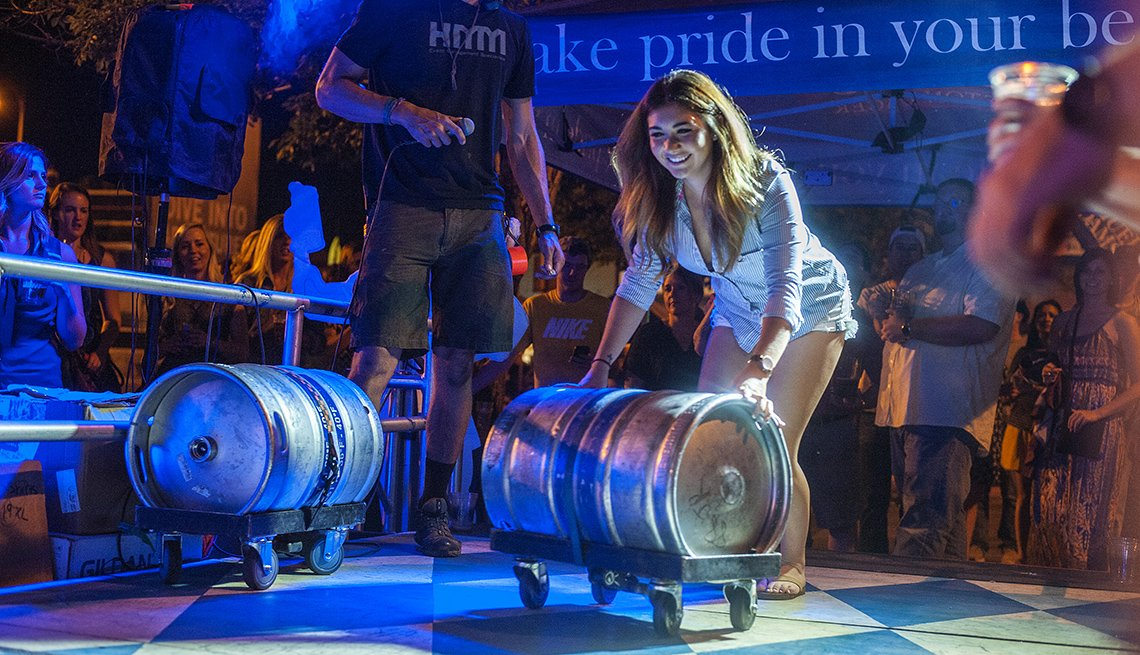 A Young Caucasian Lady Rolls A Keg Across The Stage At The Denver Oktoberfest, Oktoberfest Destinations USA