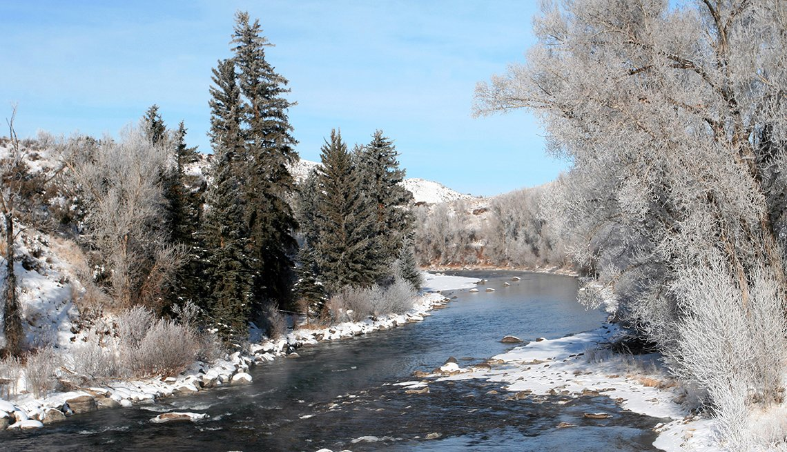 Snow Covered Trees And Ground By The Creek, Dude Ranch Vacations