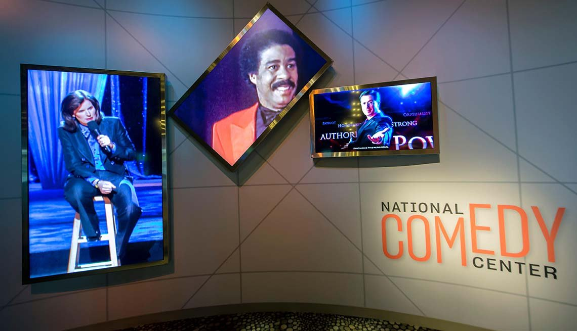 Video screens at the National Comedy Center