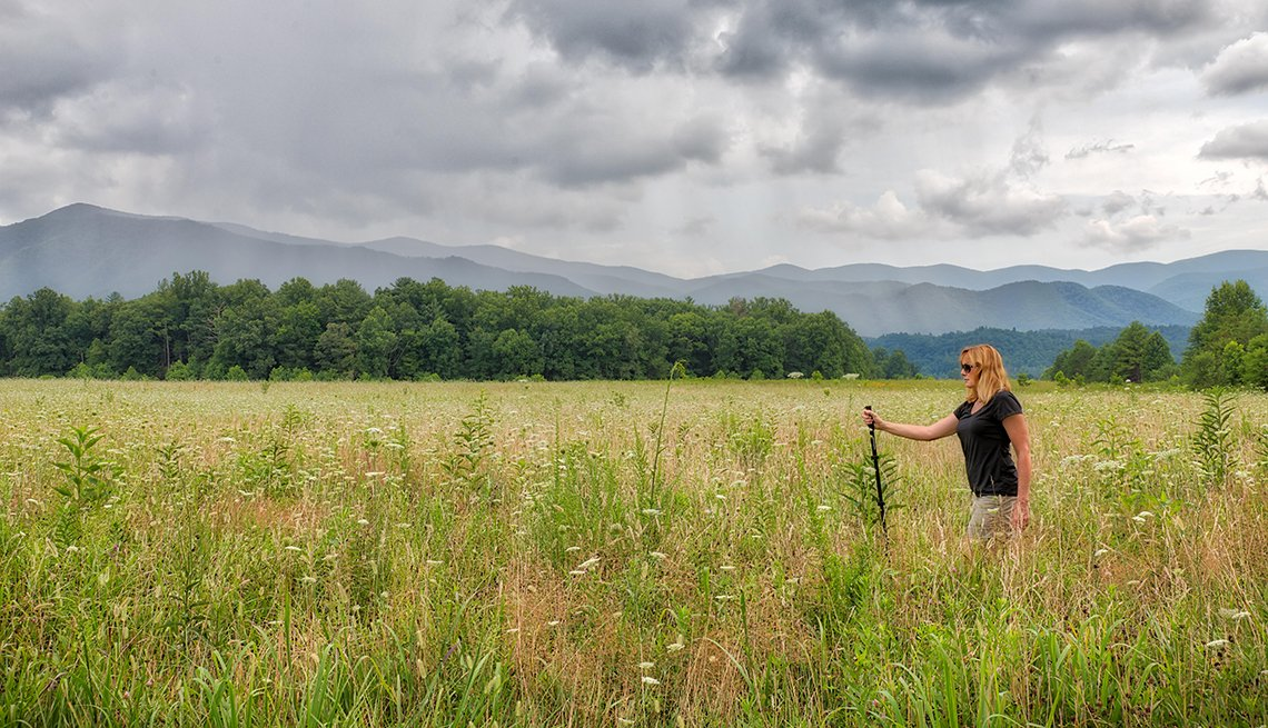 Woman walking on a cloudy day in the meadows at the Great Smoky Mountains