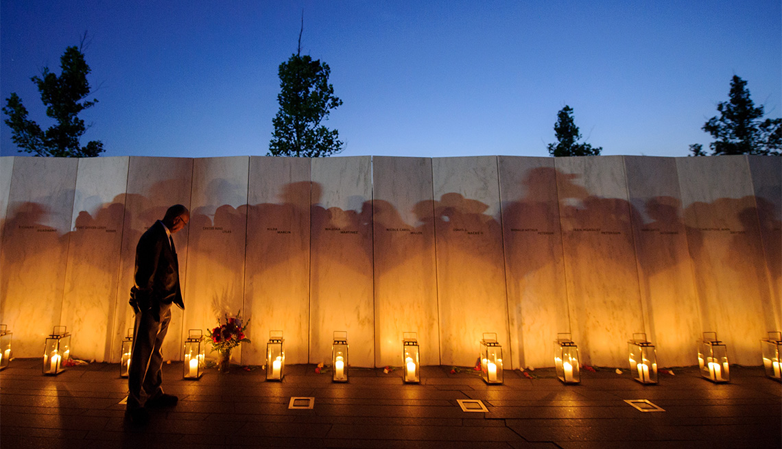 A man pauses before a name on the wall during the Flight 93 National Memorial's annual Luminaria