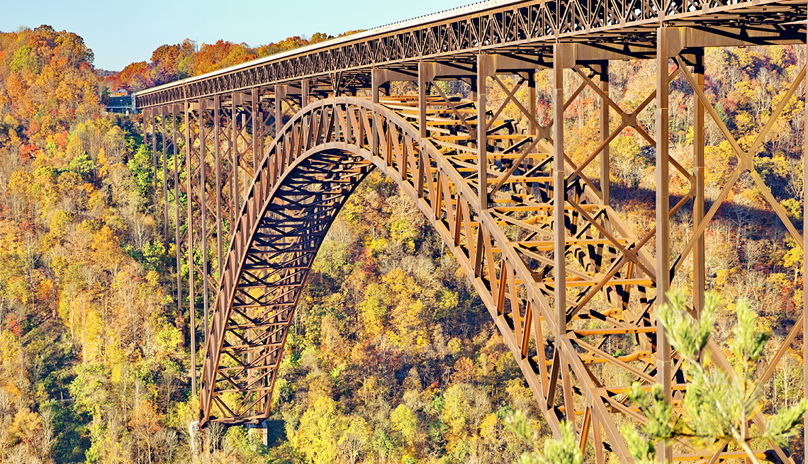 item 3 of Gallery image - Beautiful autumn sunrise light photo of the the New River Gorge, single-span arch bridge in full autumn colors