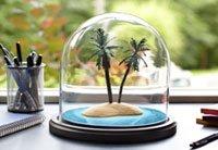 5 maneras de hacer reservaciones - Mampara de cristal de una isla tropical en miniatura