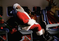 picture of Santa asleep on plane