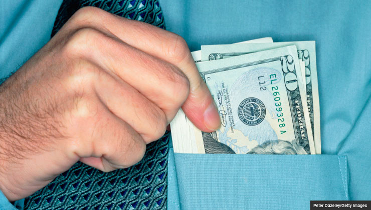man pulling dollars out of shirt pocket, hidden travel costs