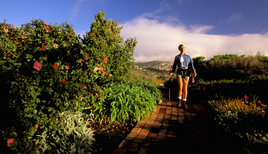 Woman Walking on the Grounds of Rancho la Puerta, Affordable Wellness Vacations