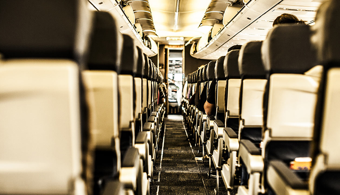 Aircraft Aisle, Line of Seats to Cabin, Ridiculous Flying Fees and How to Avoid Them
