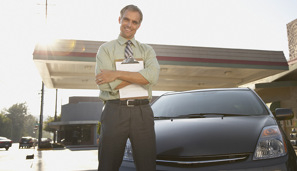 Salesman with Clipboard, Black Car, Backlit, Car Rental Do's and Don'ts