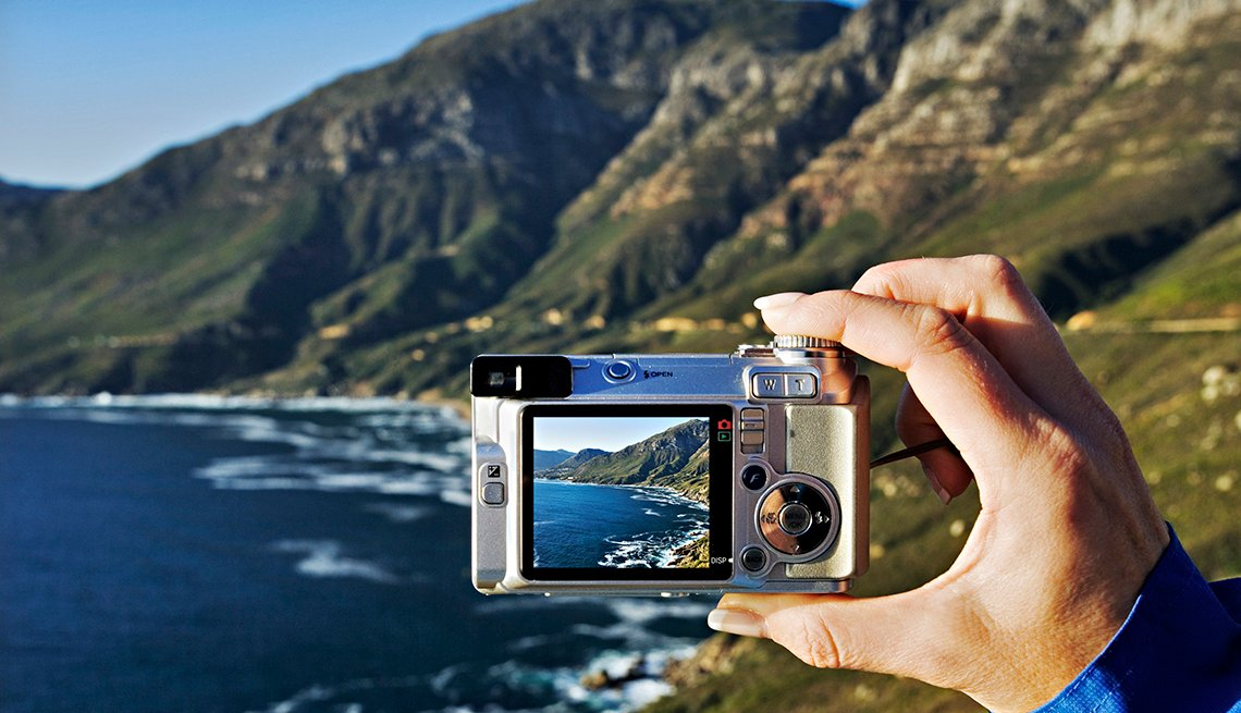 Hand Holds Digital Camera, Mountains and Ocean Waves, 5 Tips for Taking Vacation Photos