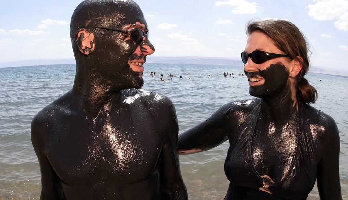 Couple Covered In Mud Near The Dead Sea In Jordan, Unique World Travel