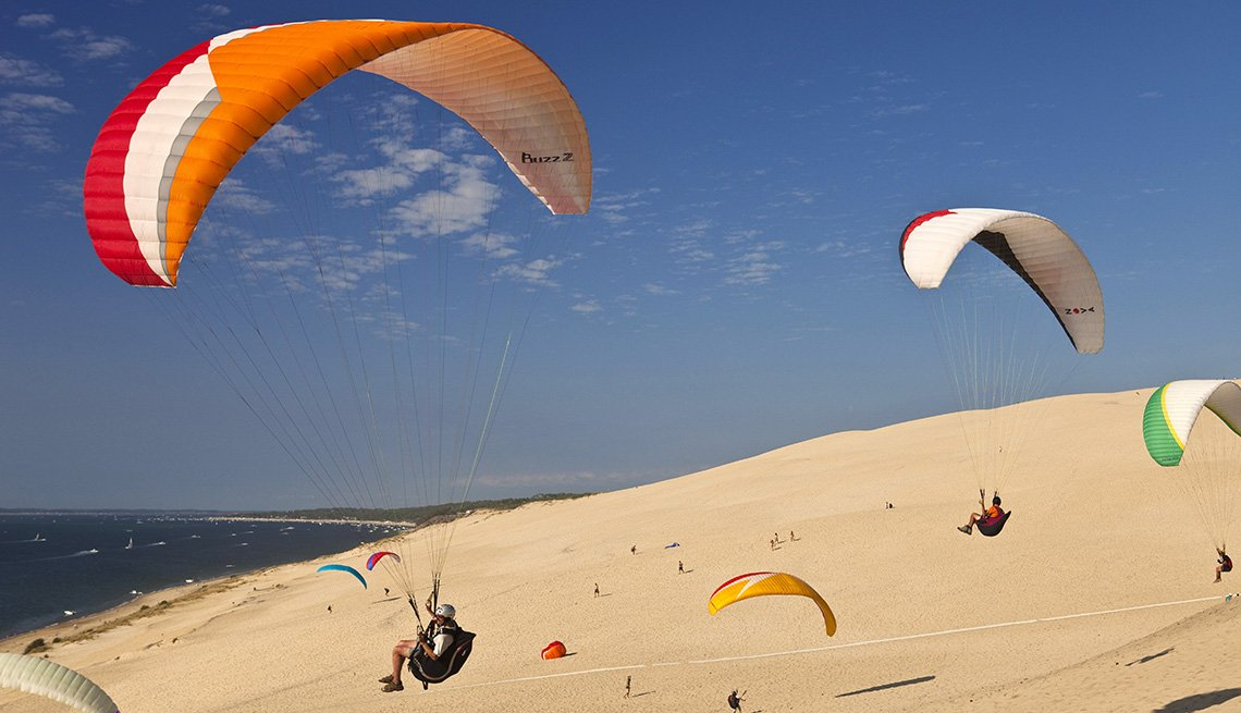 Paragliders In The Air Over The Great Dunes Of Pyla In France, Unique World Travel