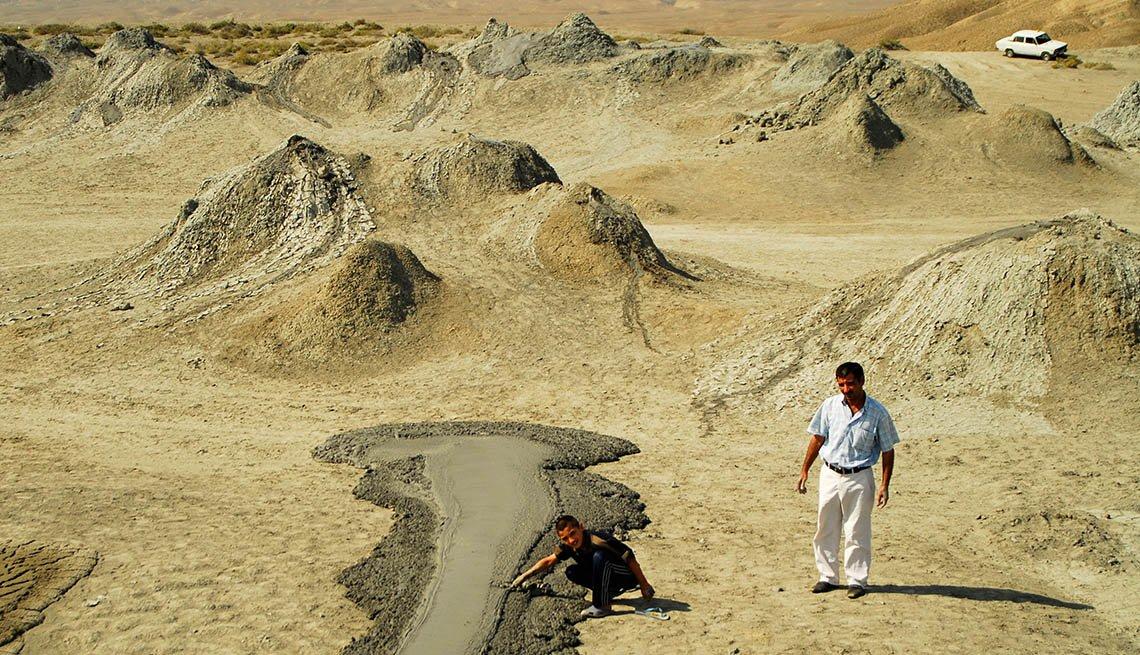 Two Men Walk Through Gobustan In Zerbaijan, Unique World Travel