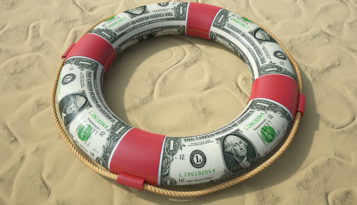 Life Belt, Dollar Bills, Sand, When to Purchase Travel Insurance