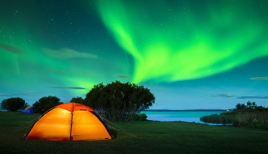 The Aurora Borealis Also Known As The Northern Lights With Tent In Foreground Seen In Iceland, Unique World Travel