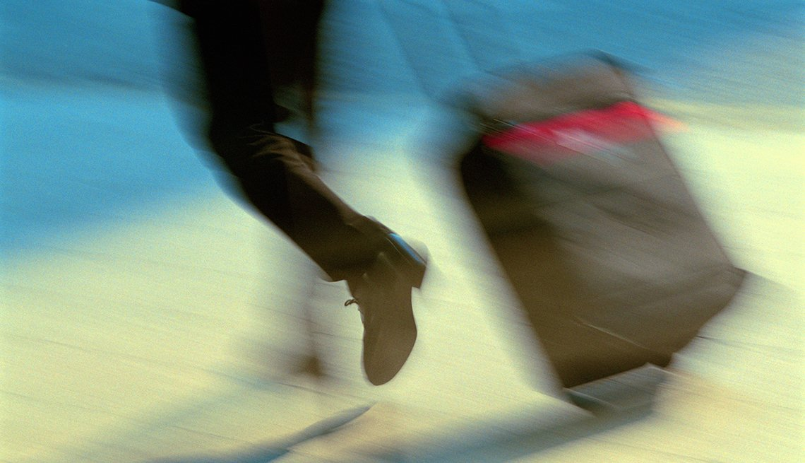 Man Runs with Suitcase, Blurred Feet Motion, 5 Common Air Travel Mistakes