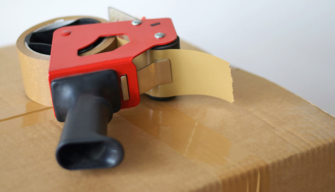 Tape Dispenser on Cardboard Box, Ridiculous Flying Fees and How to Avoid Them
