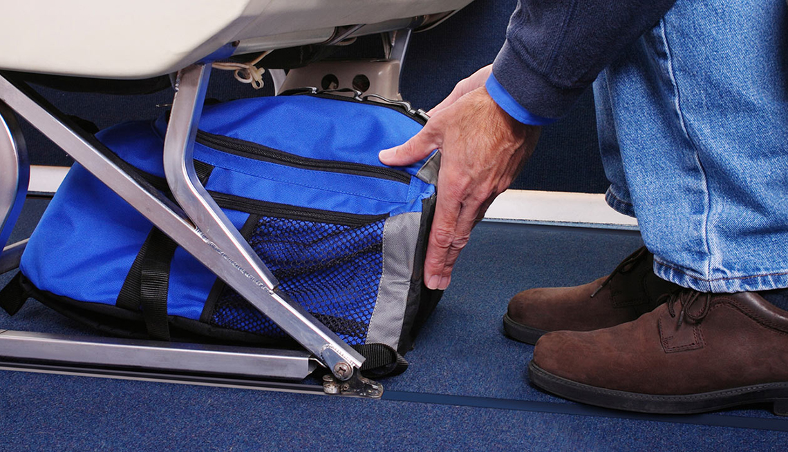 Man Blue Bag Under Airline Seat, Carryon, Ridiculous Flying Fees and How to Avoid Them
