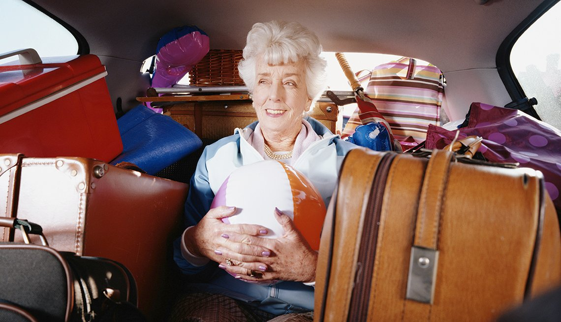 Senior Caucasian Woman, Beach Ball Luggage, Back Seat, Tips for Booking Last-Minute Travel