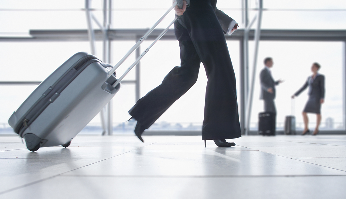 Woman Suitcase Terminal, Ridiculous Flying Fees and How to Avoid Them