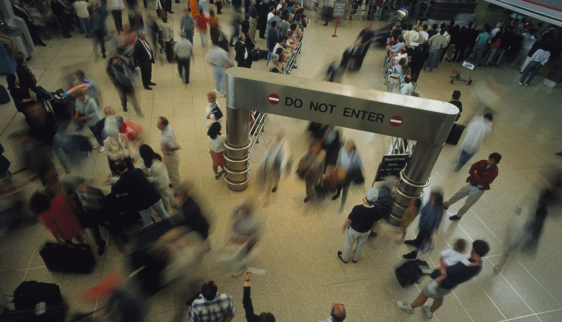 Passengers Stream Out of Arrivals Gate, Overhead View Crowds Motion, Worst U.S. Airports for Delays