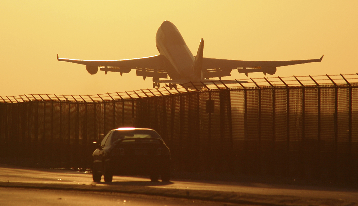 Airplane Taking Off, Car on Road by Fence, Tips for Stretching Your Car Rental Dollars