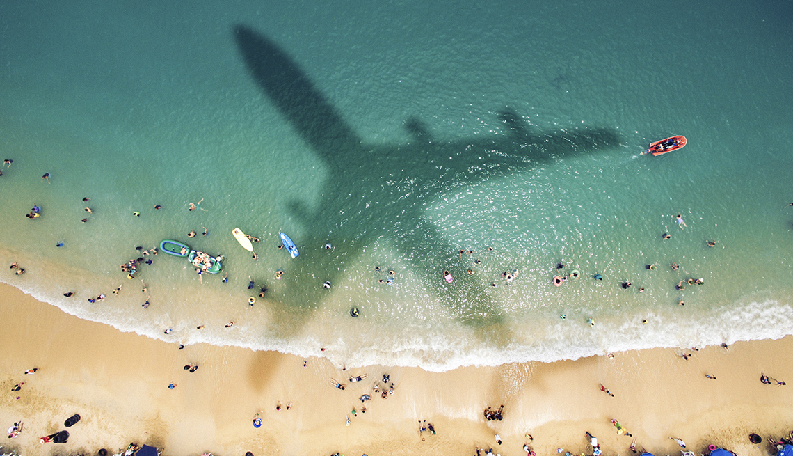 Airplane Shadow, Beach Water People, Strategies for Scoring Last-Minute Travel Deals