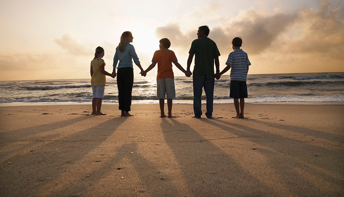Family Holding Hands, Backlit Beach Sunrise, Outer Banks, North Carolina, Great Places for a Multigenerational Vacation