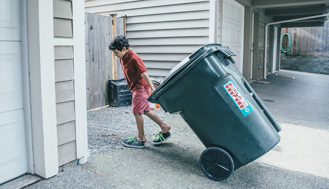 Boy with Garbage Can, Tips to Keep Your Home Safe While You're Away