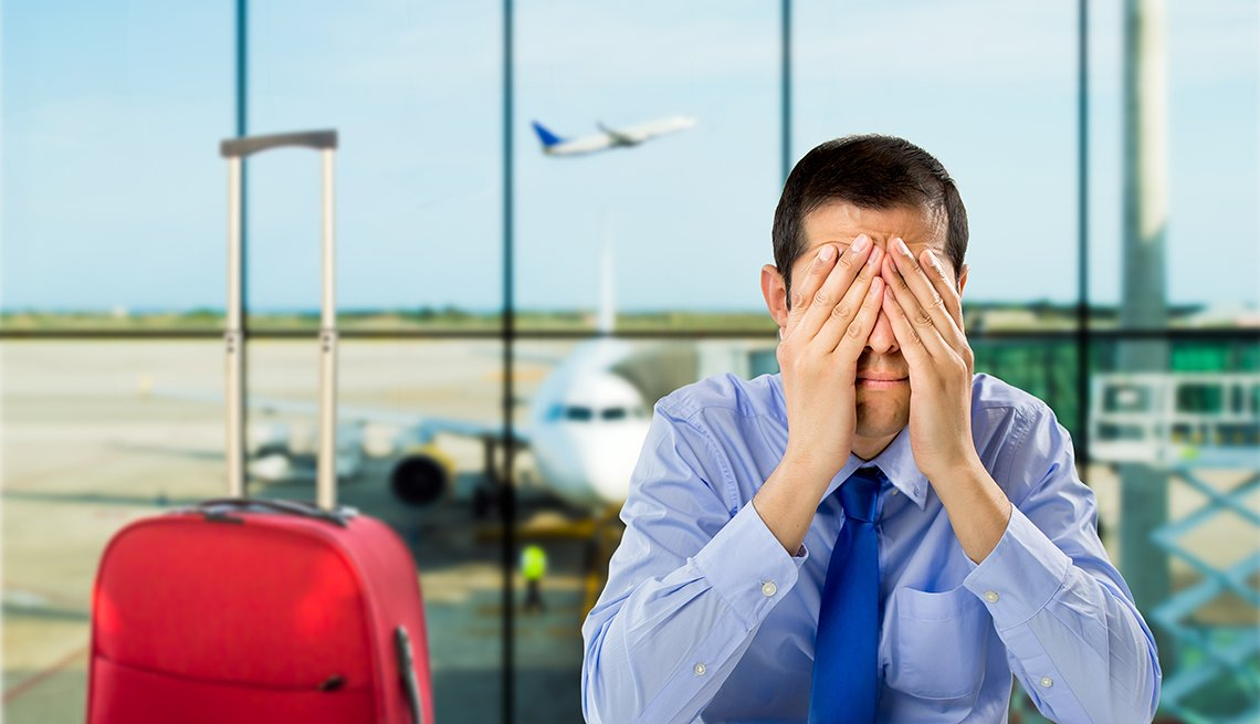 Businessman Covers Eyes, Red Suitcase, Airport Boarding Gate, Surprising Airline Rules