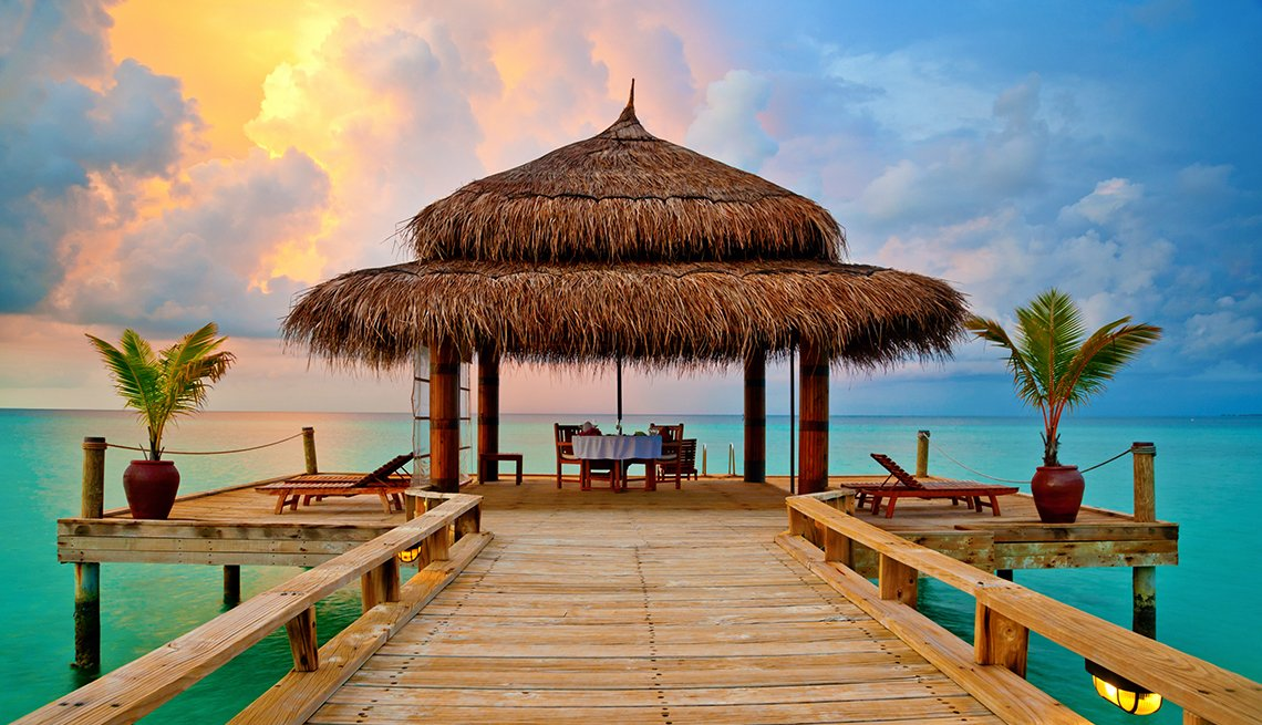 Tropical Ocean Sunset, DinneTr able Cabana. How to Break Your Vacation Debt Cycle