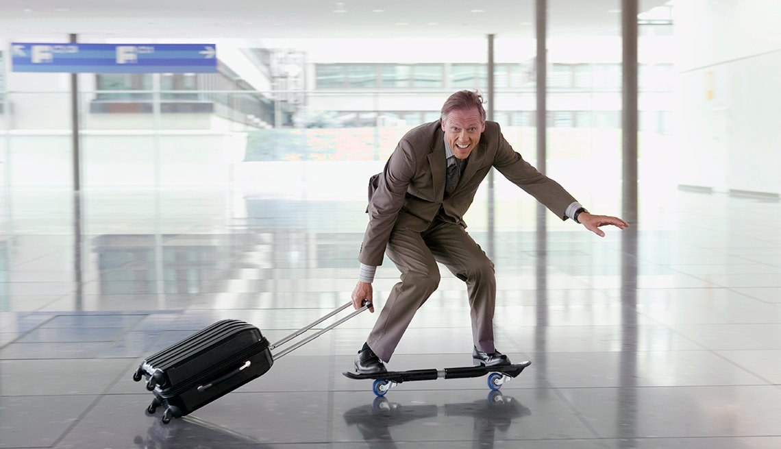 Businessman Riding Waveboard and Pulling Luggage, Samantha Brown's Tips for Choosing Luggage