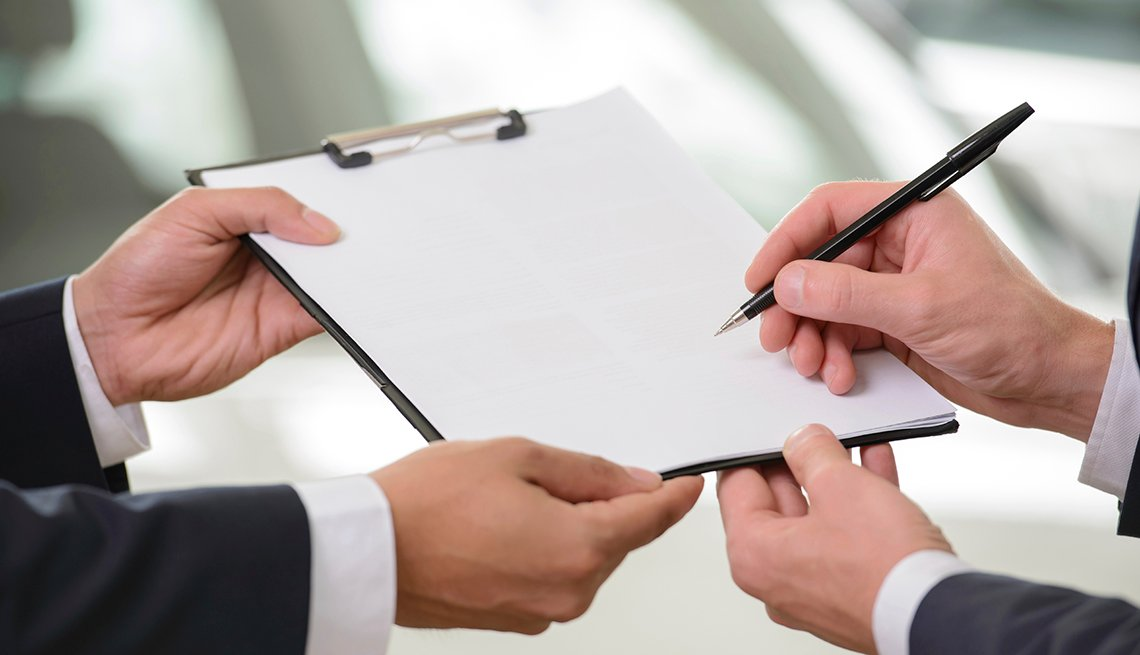 Hands Signing Paper Clipboard, Tips for Stretching Your Car Rental Dollars