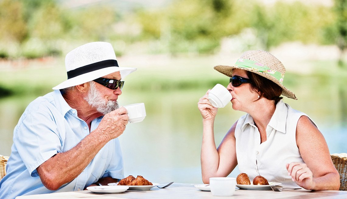 Middle Aged Caucasian Couple Enjoy Breakfast Outdoors, Pros And Cons Of All Inclusive Resorts