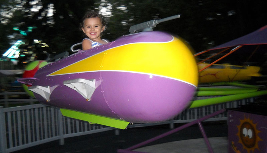 Little Girl On A Ride At Dutch Wonderland In Lancaster Pennsylvania, Best Amusement Parks For The Family