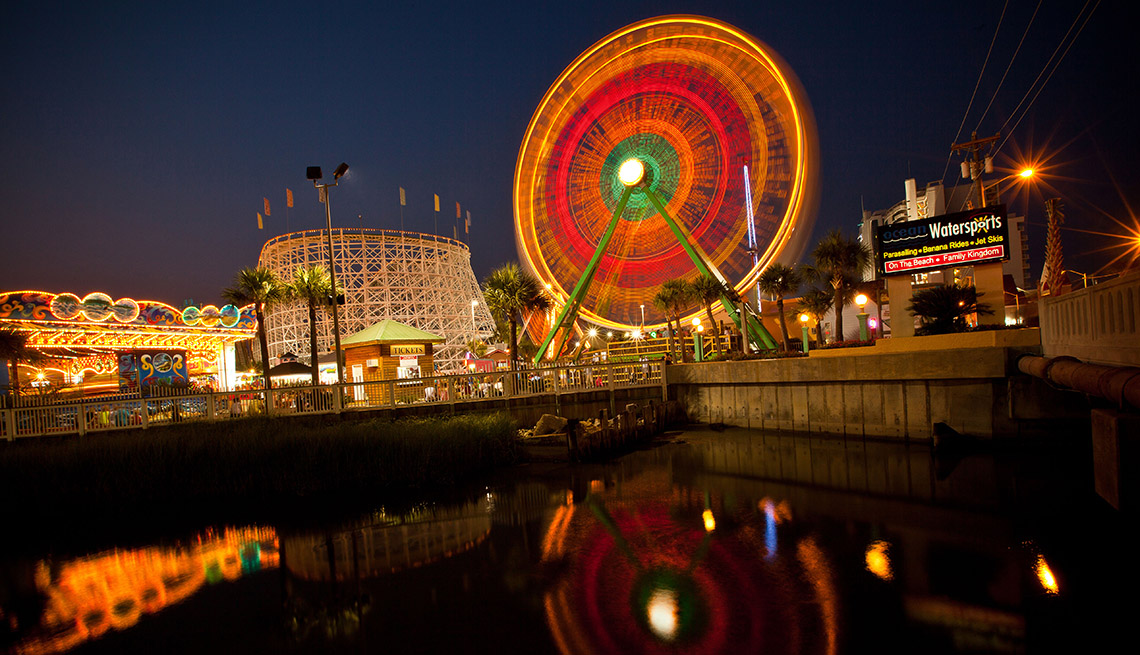The Ferris Wheel Is All Lit Up At Night At Family Kingdom In Myrtle Beach South Carolina, Best Amusement Parks For The Family