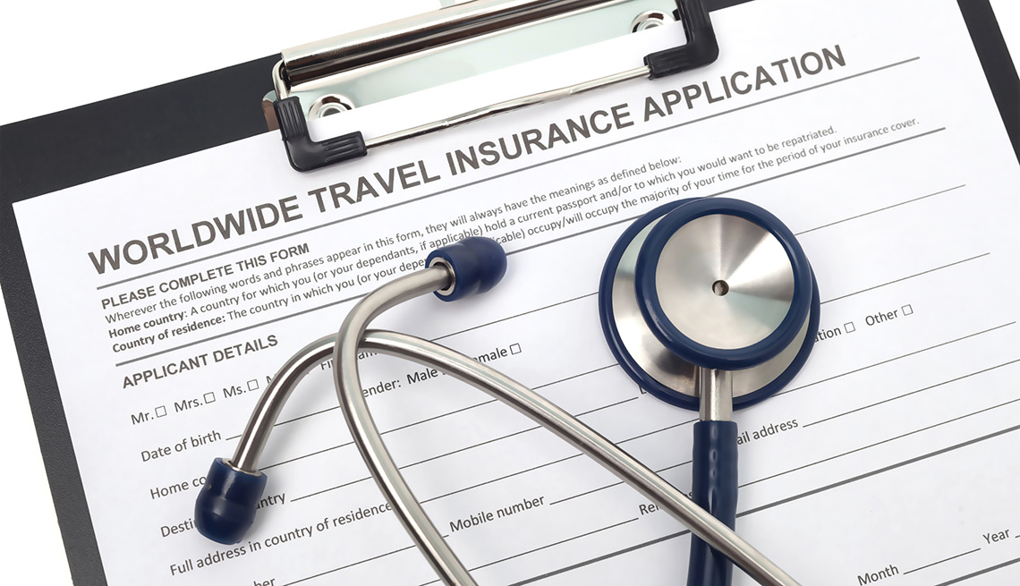 Travel Insurance Application On Clipboard With Stethoscope On Top, Should You Buy Travel Insurance?