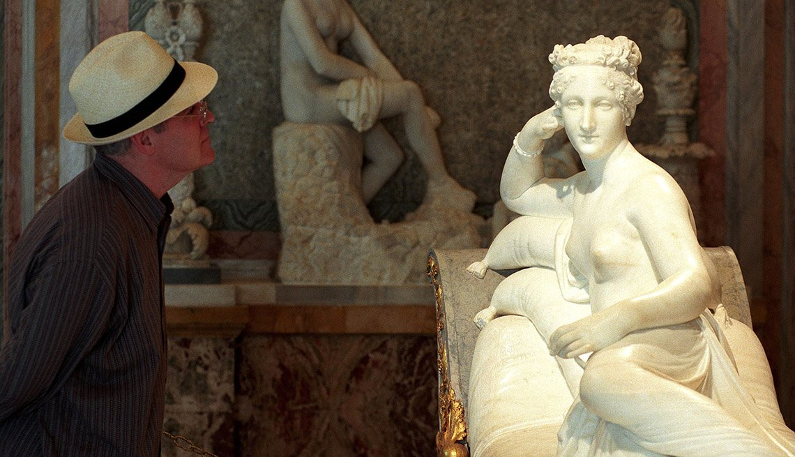 Man Looks At Statue In The Galleria Borghese In Rome Italy, Places To Visit In Rome