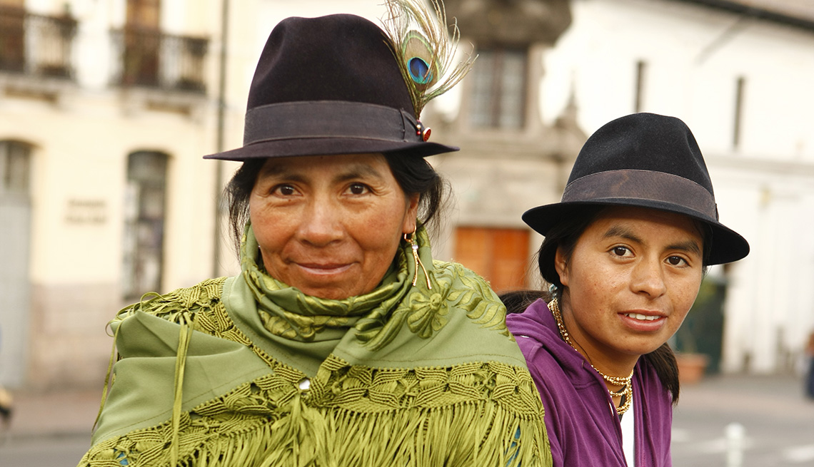 Two Hispanic Women Pose In Street, Travel Photographers Share Their Tips For Better Photos