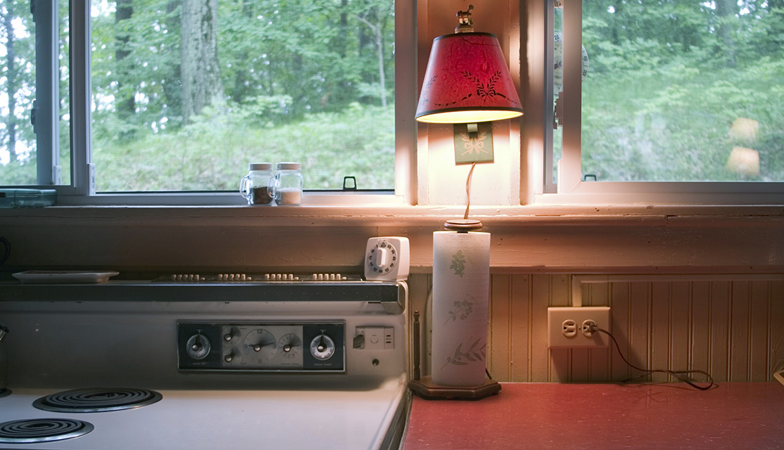 Kitchen Light on Window, Tips to Keep Your Home Safe While You're Away