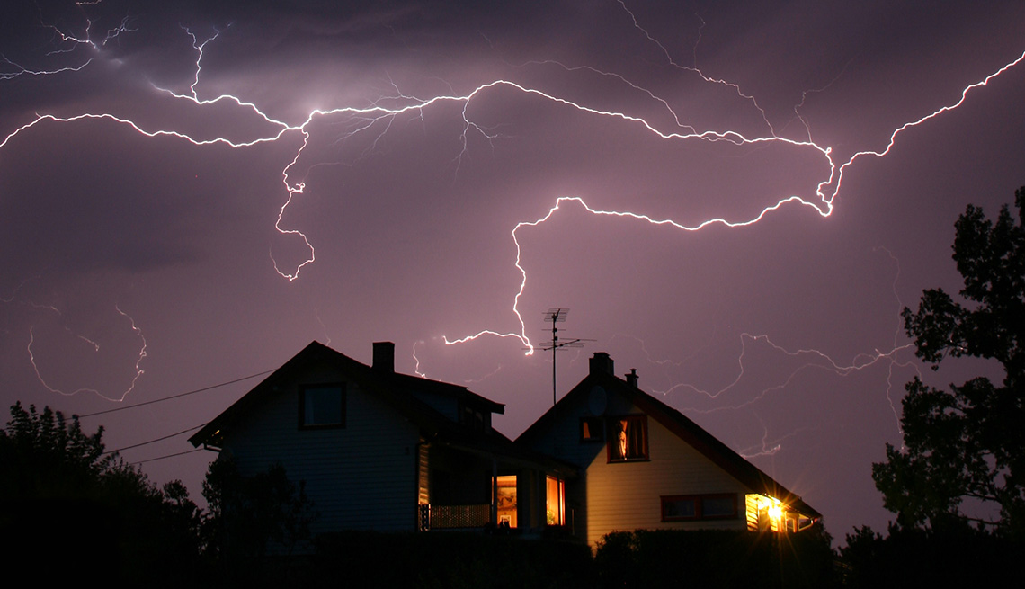 Lightning Over Houses at Night, Tips to Keep Your Home Safe While You're Away