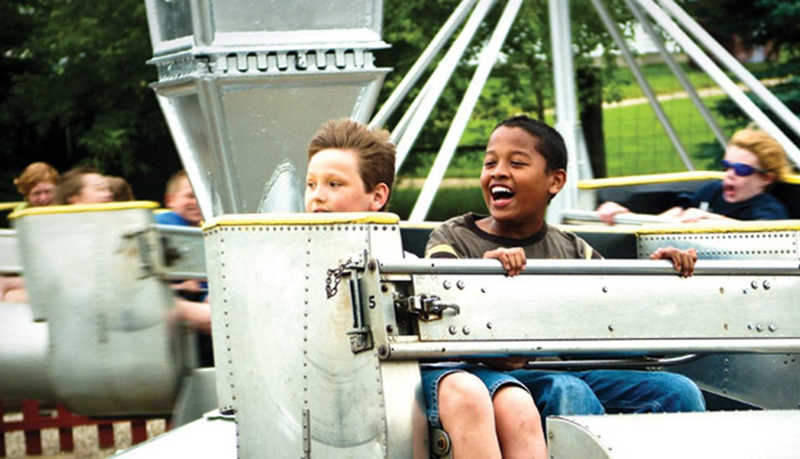 Two Boys Enjoy A Ride At Little Amerricka In Marshall Wisconsin, Best Amusement Parks For The Family