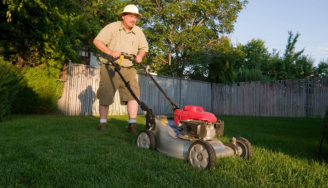 Man Mows Lawn, Fence Grass Yard, Tips to Keep Your Home Safe While You're Away