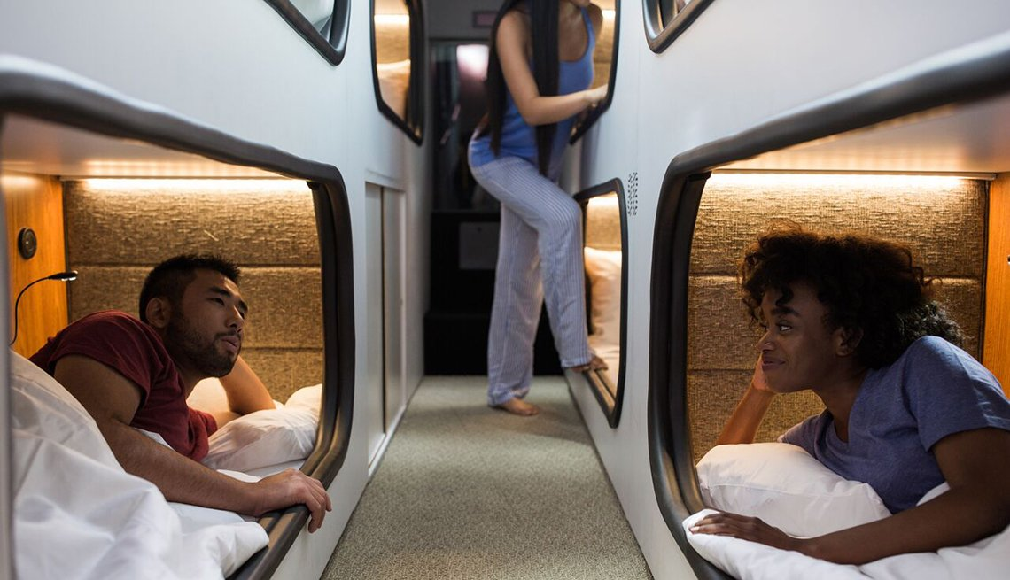 Asian-American Man African-American Woman Talk, Bunk Beds, California Bus Service Hopes to Fly Past Airlines