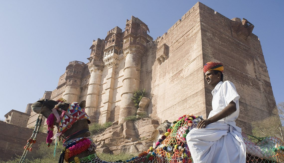 Man Rides Camel In Front Of Mehrangarh Fort, Jodhpur, Rajasthan, India, World's Best Castles