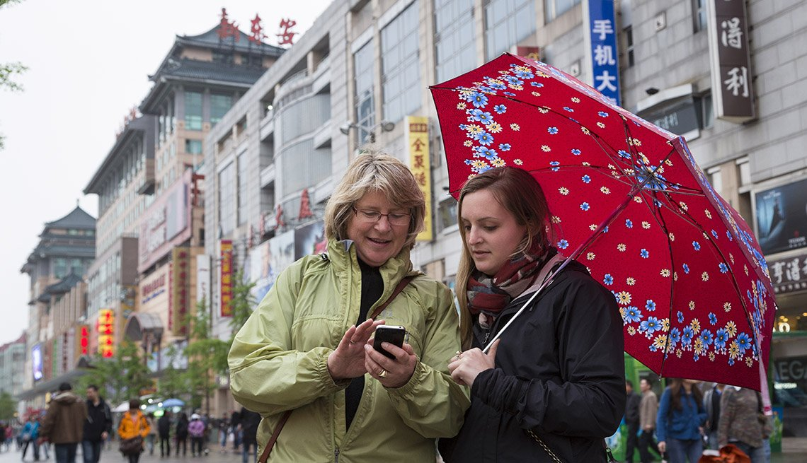 Mother And Adult Daughter Look At Their Cell Phones In Bejing China Spending Quality Time Together, Quality Time With Your Grownup Kids