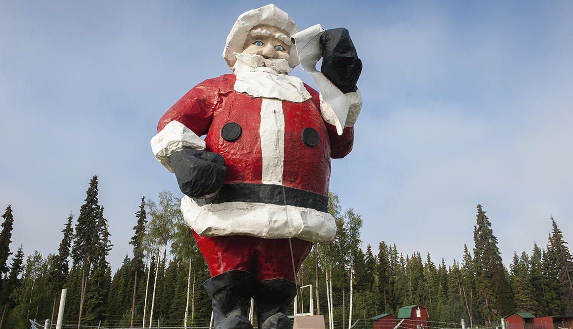 Roadside Santa statue in the Christmas themed town of North Pole, Alaska, Towns That