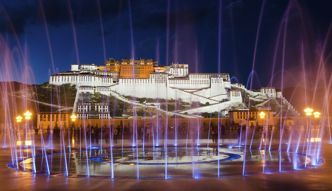 Fountains Spray Water In The Air At Night In Front Of Potala Palace In Tibet, World's Best Castles