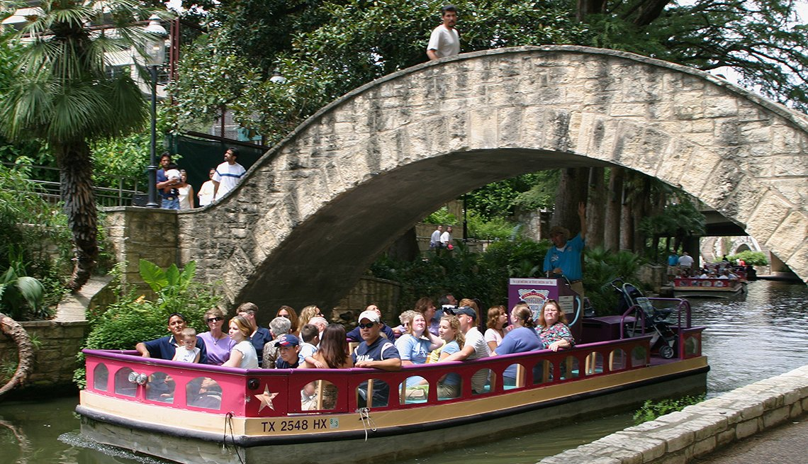 Tour Boat under a Bridge, San Antonio River Walk, Great Places for a Multigenerational Vacation