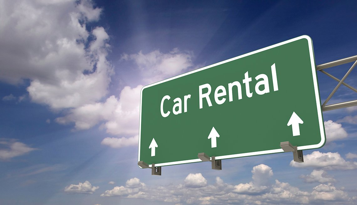 A Car Rental Direction Sign, Clouds, Tips for Stretching Your Car Rental Dollars