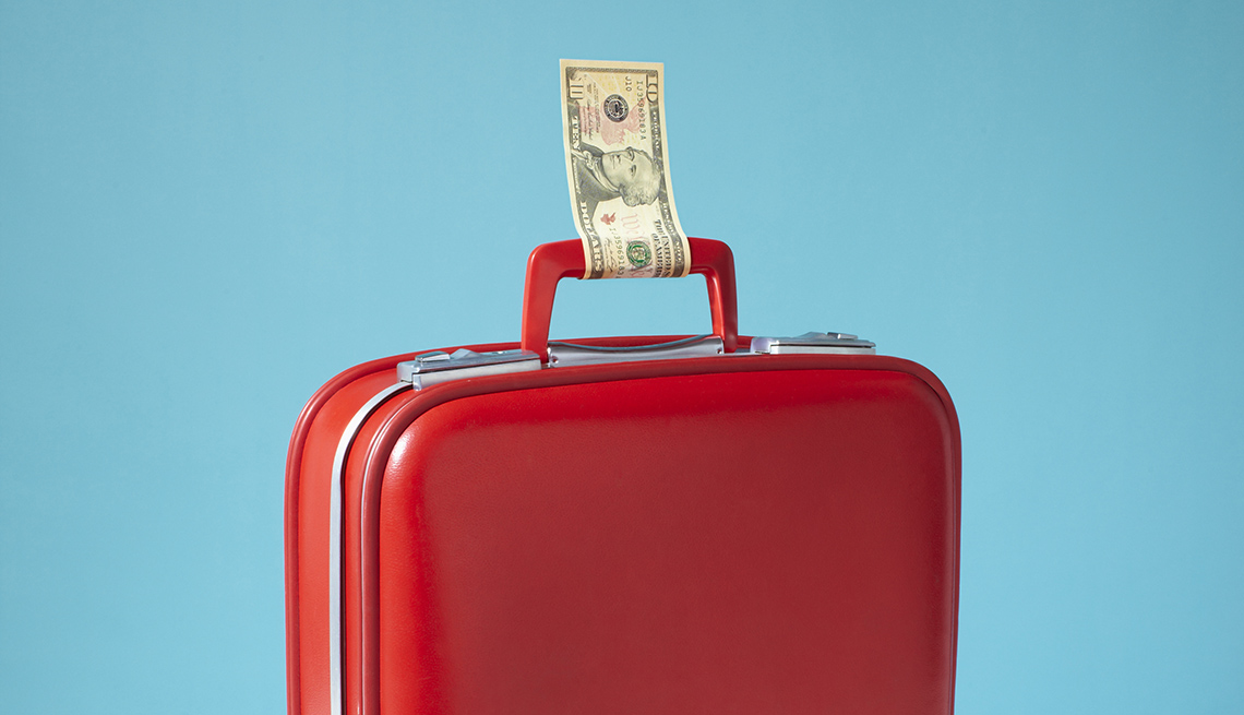 Red Suitcase With Money Tied To Handle How Save On Airfare